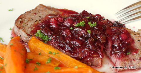 Steak with pomegranate-berry sauce  and orange sweet  potato wedges
